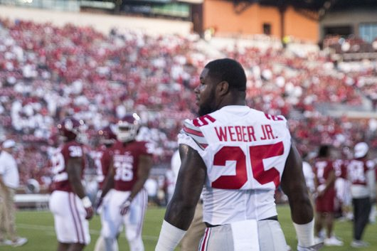 OSU redshirt freshman running back Mike Weber checks out his opponent before the Buckeyes game against Oklahoma on Sept. 17 at Gaylord Family Memorial Stadium. The Buckeyes won 45-24. Credit: Alexa Mavrogianis | Photo Editor