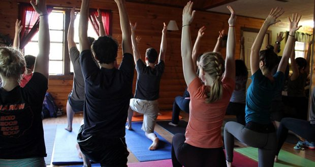 Members of the Ohio State yoga club practice during a yoga retreat in Hocking Hills in 2015. Credit: Courtesy of Alayna Reckner