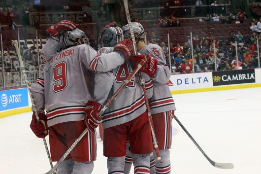 Members of Ohio State's men's ice hockey team celebrate a goal by freshman forward Tanner Laczynski (9) in the third period of the Buckeye's game against Bowling Green on Oct. 22. The Buckeyes won 6-1. Credit: Breanna Crye | For The Lantern