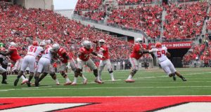 OSU redshirt junior quarterback J.T. Barrett throws toward the endzone against Rutgers on Oct. 1, 2016. Barrett broke the career passing touchdowns record in the first half. Credit: Alexa Mavrogianis | Photo Editor