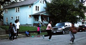 Kids play basketball on the evening of Tuesday, Oct. 4 in Weinland Park off of N 5th St. Weinland Park remains the highest density area of affordable housing in the city of Columbus, despite developers introduction of higher priced residential developments to the area.