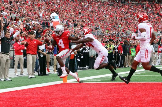 OSU junior H-back Curtis Samuel (4) rushes into the endzone for a touchdown during the first half of the Buckeyes game against Rutgers on Oct. 1. The Buckeyes won 58-0. Credit: Alexa Mavrogianis | Photo Editor