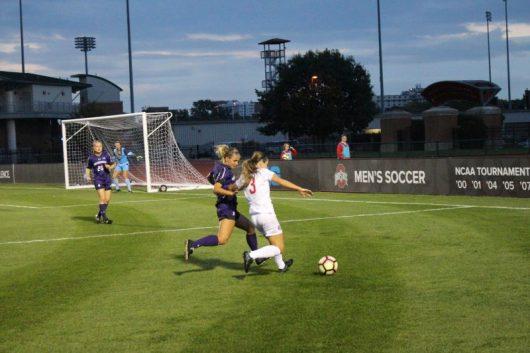 OSU senior defender Nicole Miyashiro battles a Northwestern defender for the ball on Oct. 1, 2016 at Jesse Owens Memorial Stadium. Credit: Aaron Tomich | Lantern reporter