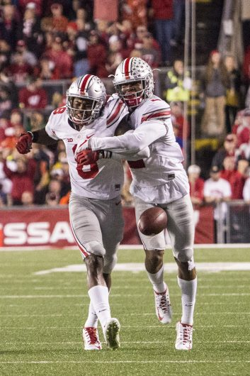 OSU redshirt junior cornerback Gareon Conley (8) and OSU redshirt sophomore cornerback Marshon Lattimore (2) celebrate Conley's first half interception during the Buckeyes game against the Badgers on Oct. 15. The Buckeyes won 30-23 in overtime. Credit: Alexa Mavrogianis | Photo Editor