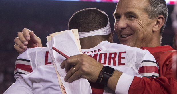 OSU coach Urban Meyer embraces redshirt sophomore cornerback Marshon Lattimore (2) following the Buckeyes 30-23 overtime win over the Wisconsin Badgers on Oct. 15. Credit: Alexa Mavrogianis | Photo Editor
