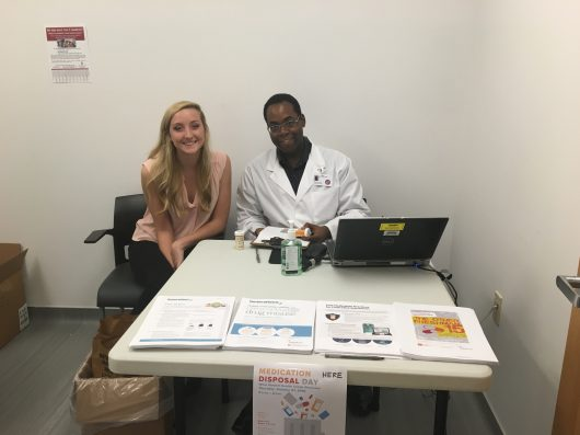 Ava Dalton and Ike Nnyamah sit prepared to accept expired and unused medications from Ohio State students on Oct. 27. Credit: Daniel Smyth Lantern Reporter
