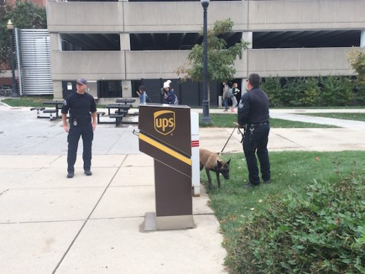 University Police officers and their dog stand outside Bolz Hall. Credit: Nick Roll   Campus Editor