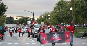 The Homecoming Parade progression walks near Tuttle Park on Sept. 30. Credit: Sherry Shi | Lantern Photographer