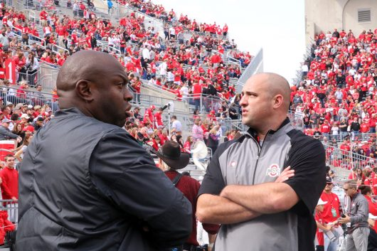 OSU coaches Tony Alfrod (left) and Zach Smith stand together before the Buckeyes game against Rutgers on Oct. 1. Credit: Alexa Mavrogianis | Photo Editor