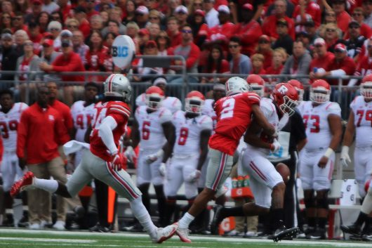 OSU redshirt sophomore cornerback Marshon Lattimore knocks the ball out of the hands of a Rutgers player during the Buckeyes game on Oct. 2. The Buckeyes won 58-0. Credit: Alexa Mavrogianis | Photo Editor