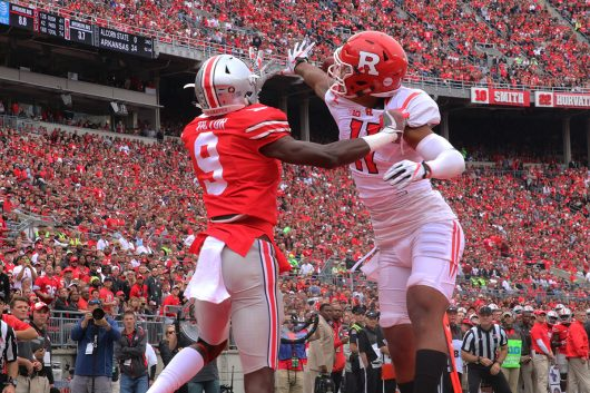 OSU freshman wide receiver Binjimen Victor (9) has the ball swatted away by Rutgers redshirt sophomore defensive back Isaiah Wharton (11) during the first half of the Buckeyes game against Rutgers on Oct. 1. The Buckeyes won 58-0. Credit: Alexa Mavrogianis | Photo Editor