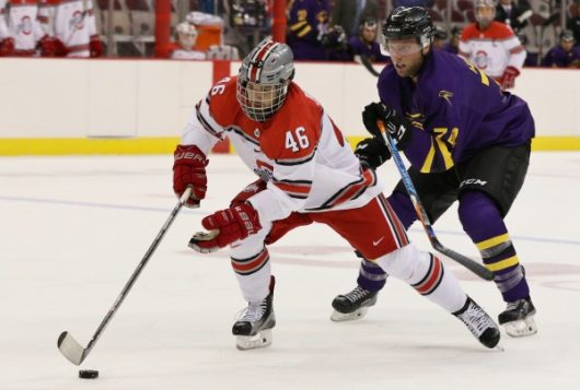 Ohio State redshirt junior defender Matt Joyaux battles for the puck against a Wilfrid-Laurier player in an exhibition on Oct. 2 at the Schottenstein Center. OSU won 9-2. Credit: Ric Kruszynski | Ohio State Athletics