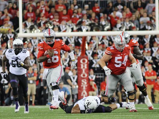 OSU Redshirt Junior Quarterback J.T. Barret (16) breaks into open field during the fourth quarter against Northwestern on Oct. 29, 2016. The Buckeyes won 24-20. Credit: Mason Swires | Assistant Photo Editor