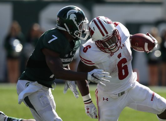 Michigan State's Demetrious Cox (7) tackles Wisconsin's Corey Clement (6) during second-half action on Saturday, Sept. 24, 2016, at Spartan Stadium in East Lansing, Mich. Wisconsin won, 30-6. (Kirthmon F. Dozier/Detroit Free Press/TNS)