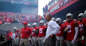 Coach Urban Meyer stands in front of the team before the Buckeyes take the field against Rutgers on Oct. 1. The Buckeyes won 58-0. Credit: Mason Swires | Assistant Photo Editor