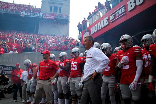 Coach Meyer stands in front of the team before the Buckeyes take the field against Rutgers on Oct. 1. The Buckeyes won 58-0. Credit: Mason Swires | Assistant Photo Editor