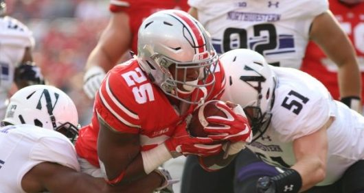 OSU redshirt freshman Mike Weber runs through Northwestern tacklers for one of his two touchdowns on Oct. 29, 2016 at Ohio Stadium. Credit: Mason Swires | Assistant Photo Editor