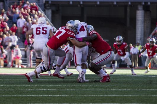 OSU freshman defensive end Nick Bosa (97) makes a tackle on Indiana sophomore running back Mike Majette (24) during the first half on Oct. 8. The Buckeyes won 38-17. Credit: Alexa Mavrogianis