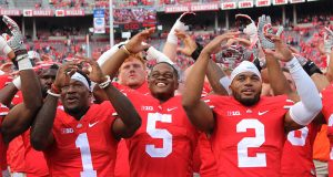Johnnie Dixon (1), Raekwon McMillan (5) and Marshon Lattimore (2) smile during the traditional rendition of Carmen Ohio after the Buckeyes game against Rutgers on Oct.1. The Buckeyes won 58-0. Credit: Mason Swires | Assistant Photo Editor