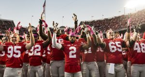 Members of the Ohio State football team celebrate their 38-17 victory over Indiana on Oct. 8 by singing 'Carmen Ohio.' Credit: Alexa Mavrogianis | Photo Editor