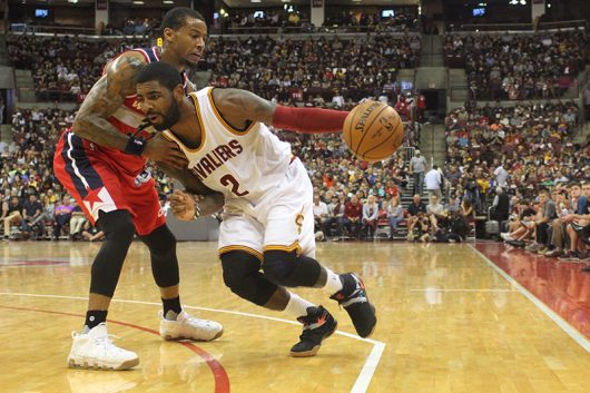 Cavaliers' Point Guard Kyrie Irving (2) tries to get through Wizards' guard Trey Burke (33) during their preseason game at the Schottenstein Center on Oct. 18. The Cavs lost 96-91. Credit: Mason Swires | Assistant Photo Editor