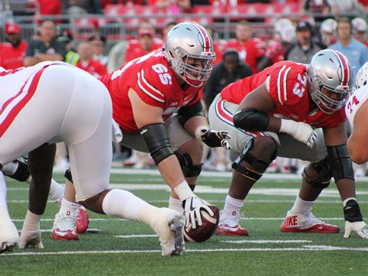 OSU center Pat Elflein (65) looks across the line of scrimmage during the second half against Indiana on Oct. 8. The Buckeyes won 38-17. Credit: Mason Swires | Assistant Photo Editor
