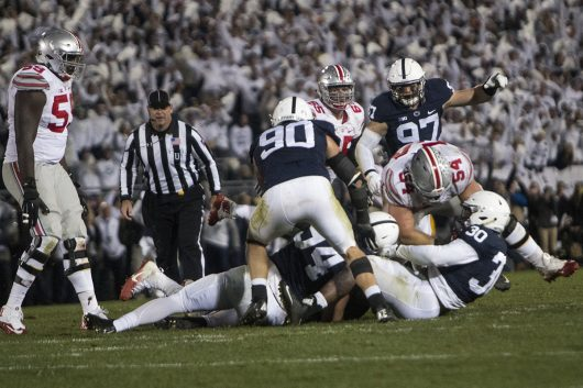 The Penn State defense tackles OSU redshirt junior quarterback J.T. Barrett late in the fourth quarter to solidify a 24-21 victory over the Buckeyes on Oct. 22. Credit: Alexa Mavrogianis | Photo Editor