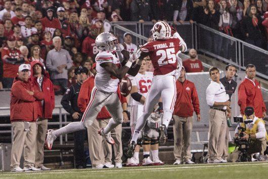 OSU redshirt sophomore Noah Brown has the ball batted away by Wisconsin junior quarterback Derrick Tindal. Credit: Alexa Mavrogianis | Photo Editor