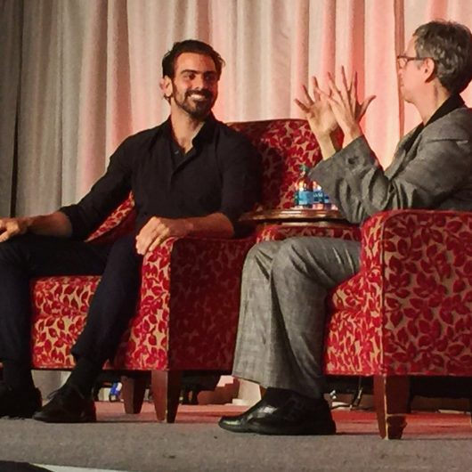Nyle DiMarco, a deaf male model, addresses a crowd at the Ohio Union on Oct. 17, through an American Sign Language interpreter. Credit: Courtesy of the Ohio Union Activities Board
