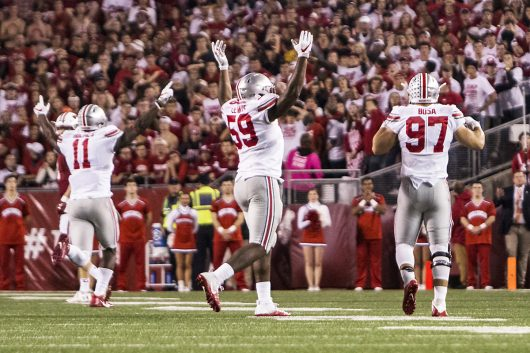 OSU defensive ends junior Jalyn Holmes (11), redshirt junior Tyquan Lewis (59) and freshman Nick Bosa (97) celebrate after a play in the second half of the Buckeyes game against the Badgers on Oct. 15. The Buckeyes won 30-23 in overtime. Credit: Alexa Mavrogianis | Photo Editor