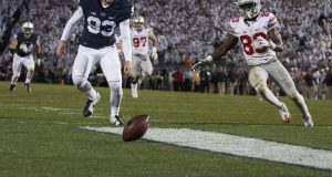 Penn State freshman punter Blake Gillikin (93) and OSU redshirt sophomore wide receiver Terry McLaurin (83) rush towards the ball after a blocked punt in the second half of the Buckeyes game on Oct. 22. The Buckeyes lost 24-21. Credit: Alexa Mavrogianis | Photo Editor