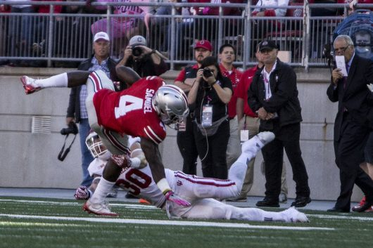 OSU junior H-back Curtis Samuel (4) attempts to evade a tackle during the first half against Indiana on Oct. 8. The Buckeyes won 38-17. Credit: Alexa Mavrogianis | Photo Editor