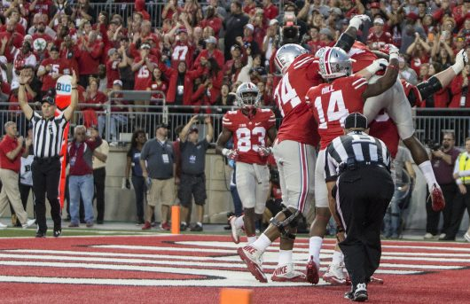 The Buckeye offense celebrate OSU junior H-back Curtis Samuel's game winning touchdown during the second half of the Buckeyes game against Northwestern on Oct. 29. The Buckeyes won 24-20. Credit: Alexa Mavrogianis | Photo Editor