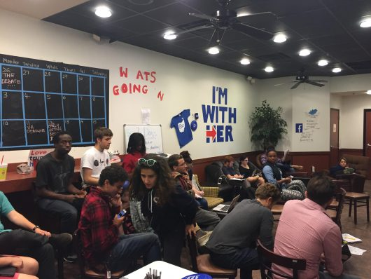 Students and supporters gather in the Hillary Clinton campaign office in Gateway to watch the vice presidential debate on Oct. 3. Credit: Abby Vesoulis | Lantern Reporter