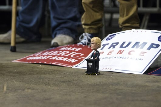 Supporters lay out Donald Trump signs and a bobblehead on the floor during a rally in Delaware, Ohio on Oct. 20. Credit: Alexa Mavrogianis | Photo Editor
