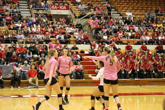 The OSU women's volleyball team celebrates after a win against Michigan State on Oct. 22. The Buckeyes won the match 3-0. Credit: Luke Swartz | For The Lantern