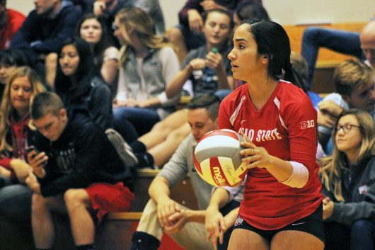 Senior libero Valeria Leon goes through her service routine during a match against Nebraska at St. John Arena on Oct. 14. Credit: Jenna Leinasars | Assistant News Director