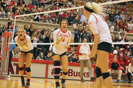 Players of the Ohio State women's volleyball team celebrate a team point during a game against Nebraska on Oct. 14. OSU lost, 3-1. Credit: Alexa Mavrogianis | Photo Editor