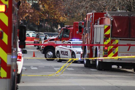 Vehicles from the Columbus Division of Fire and the Columbus Division of Police line West 19th Avenue. Credit: Mason Swires | Assistant Photo Editor
