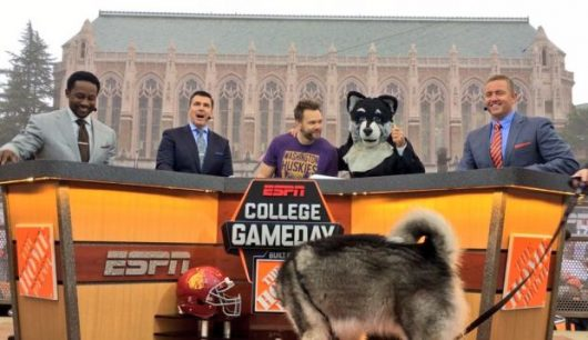 The College GameDay crew at the Washington-USC game on Nov. 12. Desmond Howard (far left) and Kirk Herbstreit (far right) played for Michigan and OSU, respectively. Credit: Courtesy of College GameDay Facebook