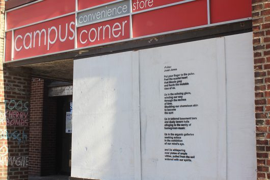 A stencil art installation entitled 'Pulse' has been placed at the vacant Campus Corner convenience storefront in part of the University District Arts and Character Enhancement Plan. Artist and OSU Alumni Jessica Jones created the poem inspired by her love of Columbus and the vibrancy of its neighborhoods. Credit: Grace Fleisher | Lantern Reporter