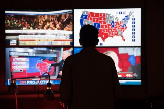 A student watches projections roll in at an election watch party in the Ohio Union on Nov. 8. Credit: Sam Harris | Assistant Campus Editor