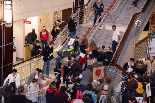 The crowd moves in after protester Tim Adams is tackled in the Ohio Union on Nov. 14. Credit: Sam Harris | Assistant Photo Editor