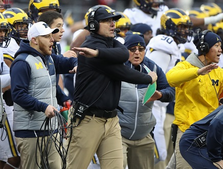 Michigan head coach Jim Harbaugh pleads for a call during the second overtime against Ohio State at Ohio Stadium in Columbus, Ohio, on Saturday, Nov. 26, 2016. Ohio State won, 30-27, in double overtime. (Kirthmon F. Dozier/Detroit Free Press/TNS)