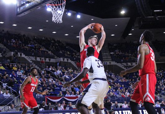 OSu freshman center Micah Potter grabs a rebound against Navy on Nov. 11, 2016. Credit: Alexa Mavrogianis | Photo Editor