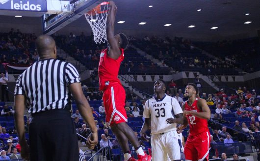 Ohio State junior forward Jae'Sean Tate slams home a dunk against Navy on Nov. 11 in Annapolis, Maryland. Credit: Alexa Mavrogianis | Photo Editor