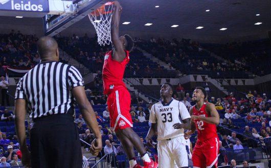 Ohio State junior forward Jae'Sean Tate slams home a dunk against Navy on Nov. 11 in Annapolis, Maryland. Credit: Alexa Mavrogianis | Photo Editor