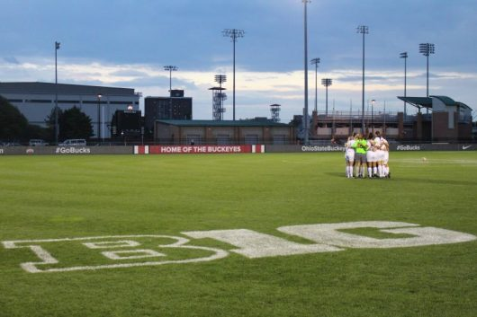 Members of the Ohio State women's soccer team huddles before a game at Jesse Owens Memorial Stadium. Credit: Aaron Tomich | Lantern Reporter