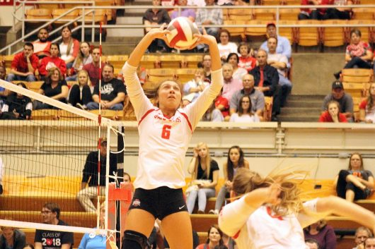 Sophomore setter Taylor Hughes (6) sets the ball during a match with Wisconsin on Nov. 2 at St. John Arena. She had 45 assists and 11 kills on Friday. Credit: Jenna Leinasars | Assistant News Director