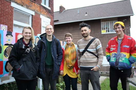"""Exhibiting artists for the """"Adult Human"""" exhibit in front of Sign House (L to R) Glenn Cox, Vincent Cohen, Audrey Galat, Forrest Roberts, Maggie Wehri (not pictured: Sarah Whitt.) Credit: Courtesy of Mona Gazala."""
